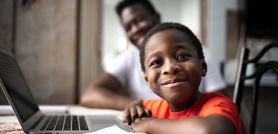 Boy with dad doing homework