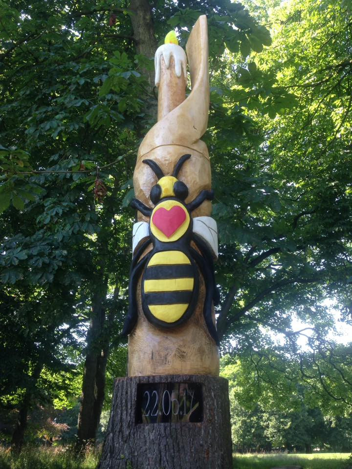Wood statue tribute in Longford Park, Stretford