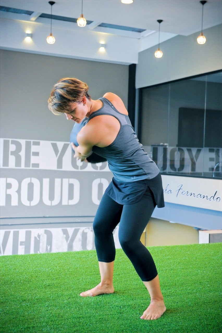 Fitness SPecialist Africa Madueno Alarcon busy in the gym working with clients to imrpove their fitness for golf and for life