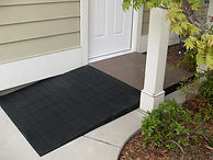 Picture of a Safe Residential Ramp in black color located at the entrance of a landing/door.