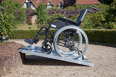 Picture of a wheelchair on an portable aluminum ramp