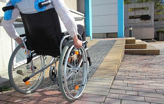 Wheelchair user using a custom built brick ramp