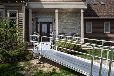 Aluminum ramp with handrails installed at a home