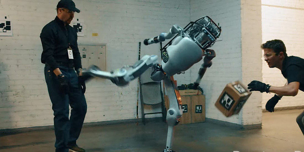 An AI robot kicking a human