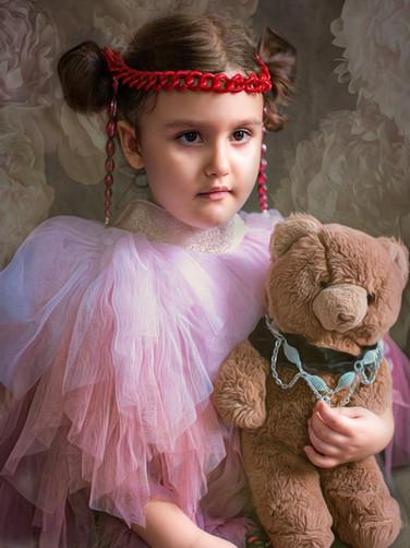 Girl with a teddy bear
