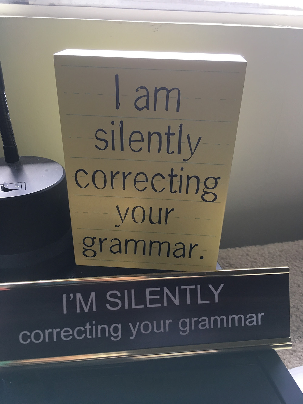 Wooden sign that says I am silently correcting your grammar.