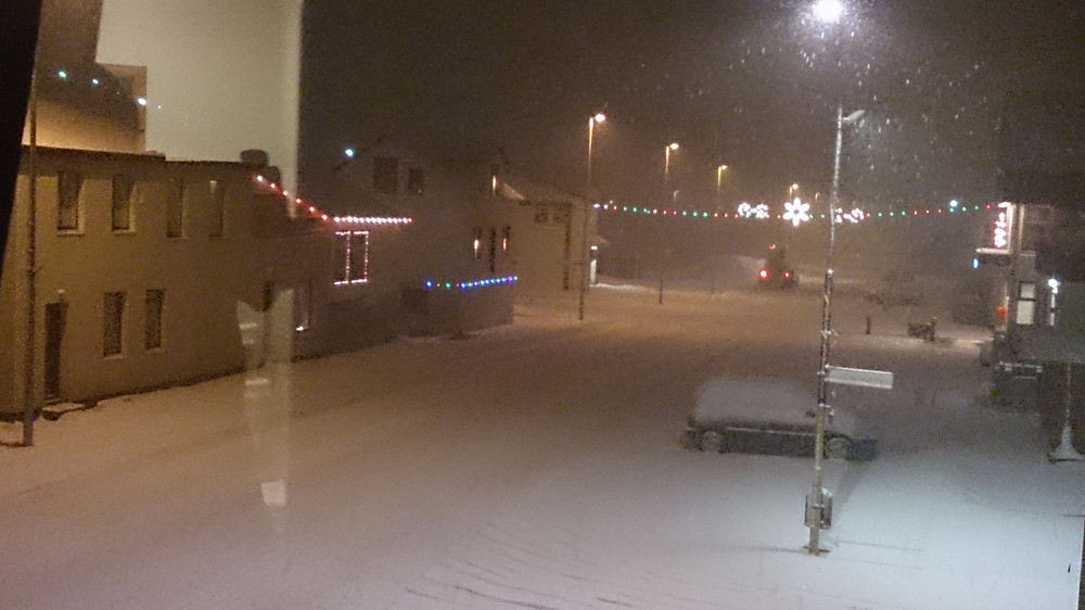 A picture of Olafsfjordur main street, buried in snow.