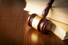 Gavel proped against law books