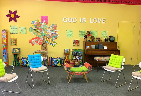 Sunday School chairs in a circle in front of a colorful wall with a tree of qualities - the content of your character