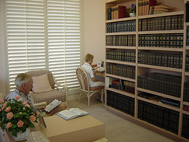 Study room inside the Reading Room with two individuals reading the weekly Bible Lesson.