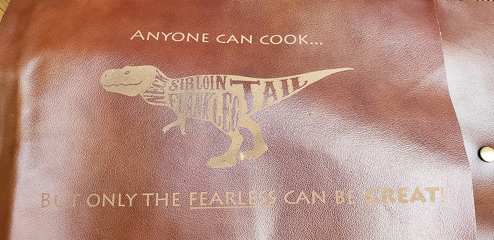 Dinosaur laser etched leather