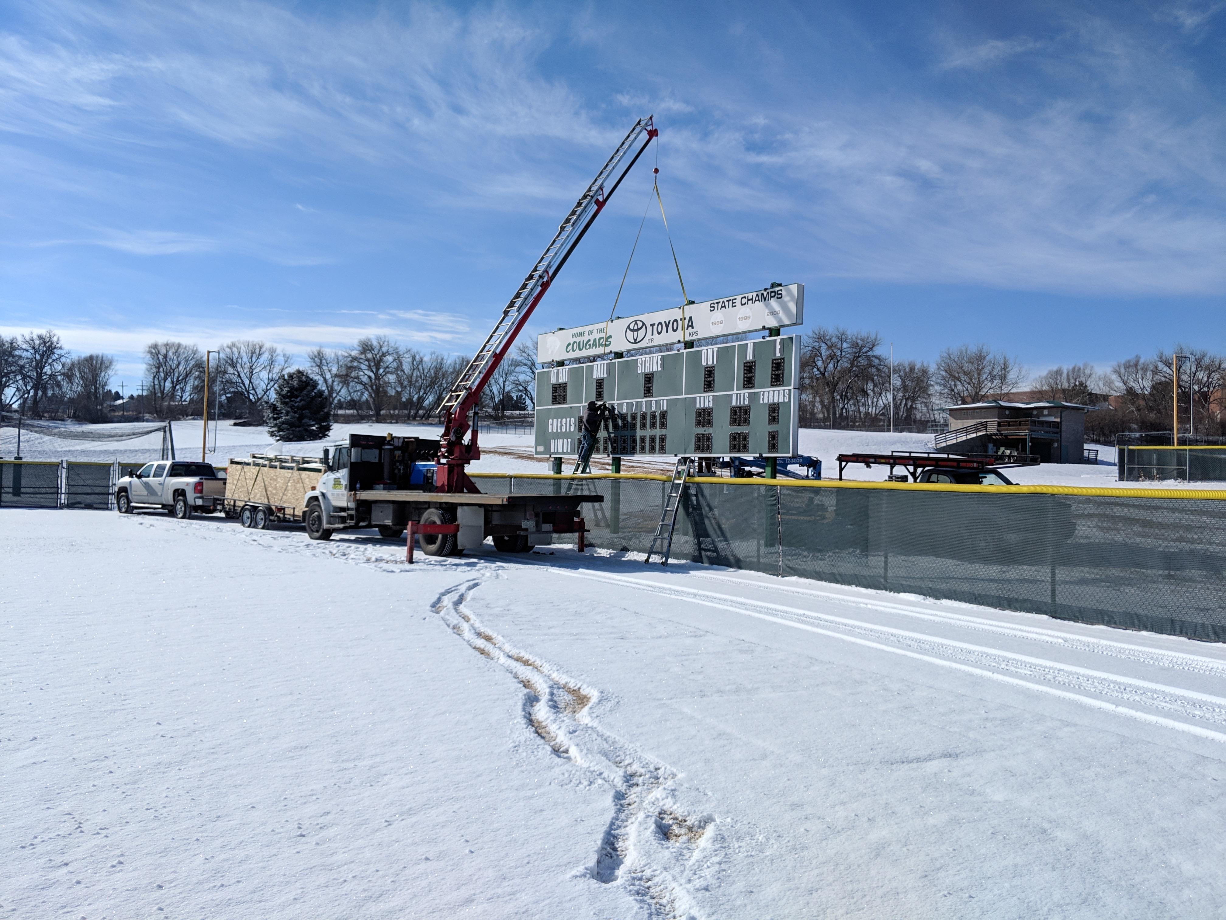 Crane Install of Cougars Scoreboard