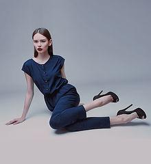 Model in blue silk jumpsuit