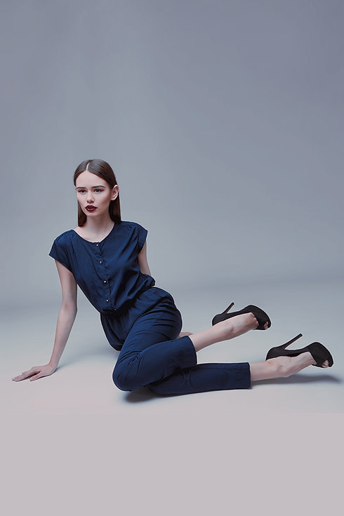 Model in blue silk jumpsuit