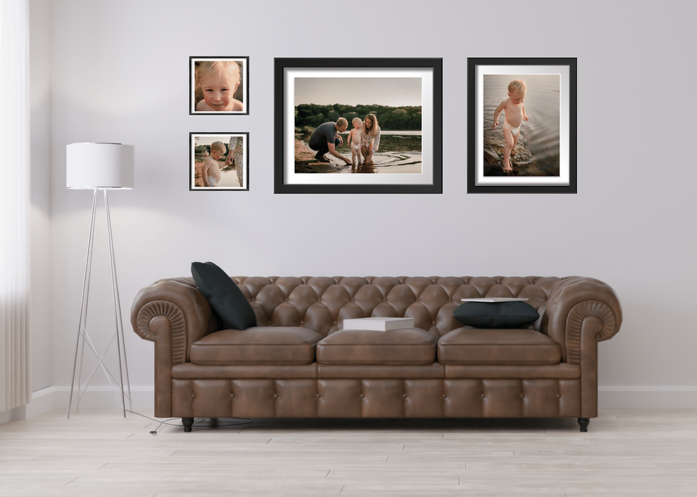 Living room gallery wall created by a Maple Grove Newborn photographer