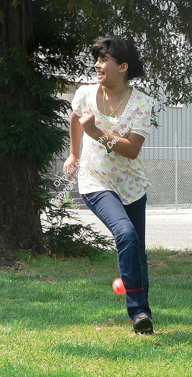 Teenaged girl playing yard soccer smw.jp
