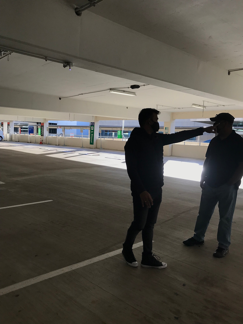 Senior Art Director Satish Dusa discusses a marketing campaign photo needed for Prepaid Airport Parking at DFW.
