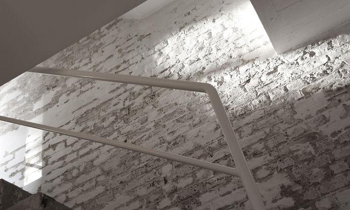Anna Valentine sunlight on brick wall in atelier