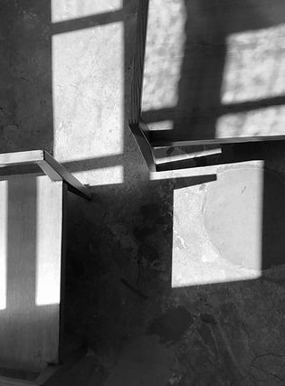 Anna Valentine atelier sunlight and shadow on wooden chairs