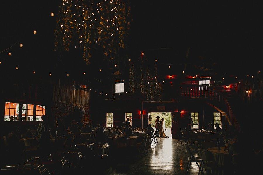 Missouri Destination Wedding reception inside Rustic Barn at Wicked Pony Ranch