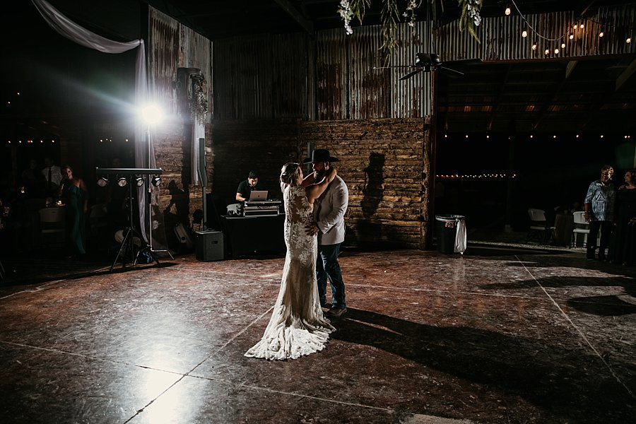 Bride and Groom dancing in the Rustic Barn at Wicked Pony Ranch