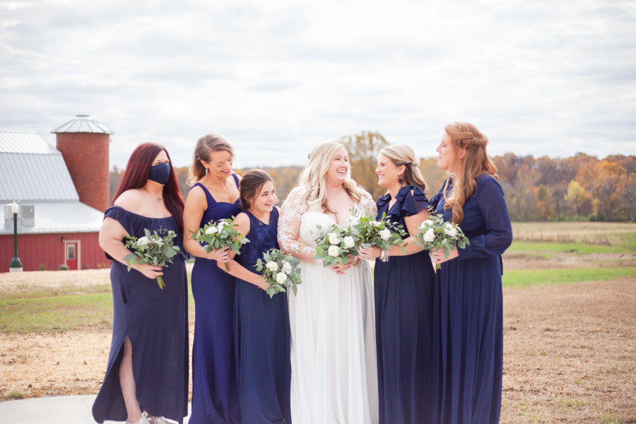 Bridesmaids with rustic barn backdrop | Red Oak Valley