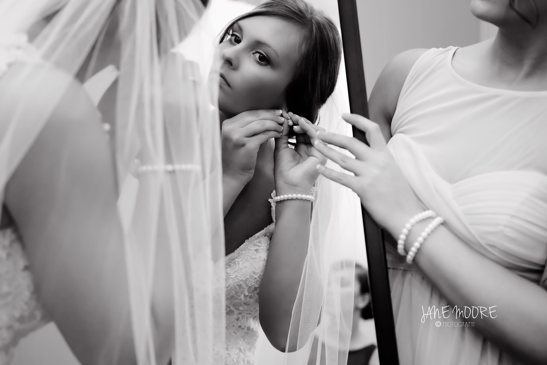 Wedding prep photo finishing touches