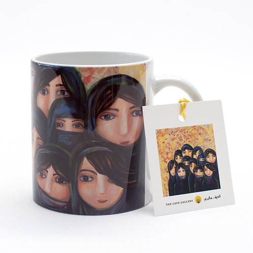 Front view of a mug with artwork of Saudi ladies