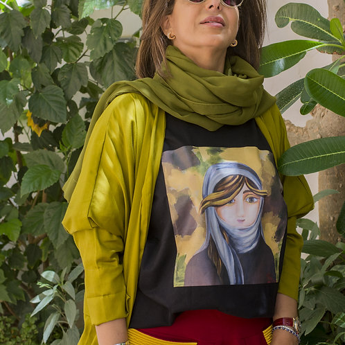 """Woman wearing black t-shirt with picture of the painting """"The Dreamer"""" portrait of a young Saudi woman"""