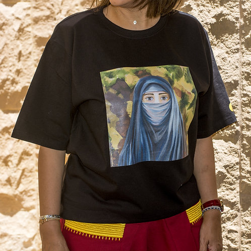 """Woman wearing black t-shirt with picture of the painting """"The Seductive"""" portrait of a Saudi woman"""