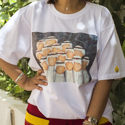 """Front view of a woman wearing white t-shirt with detail of the painting """"Al Rajajeel"""" representing group of Saudi men"""