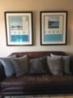 Landscape paintings by Kazaan Viveiros hanging above couch in private collector's homme, Lafayette, CA