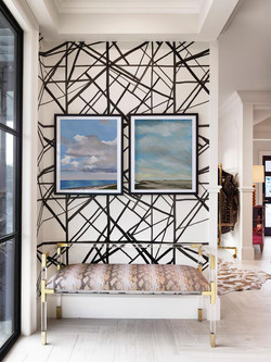 Try layering art with wallpaper.