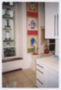 Contemporary paintings by Kazaan Viveiros hanging in Danielle Steel's kitchen in Paris