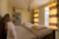 Apartment style suite with queen bed in Huye, Rwanda