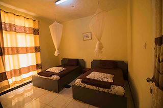 Hotel room with two twin beds in Huye, Rwanda