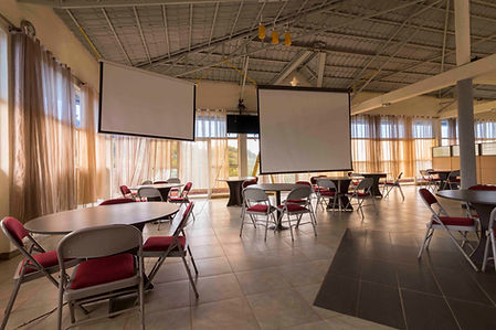 Conference room with projection screens in Huye