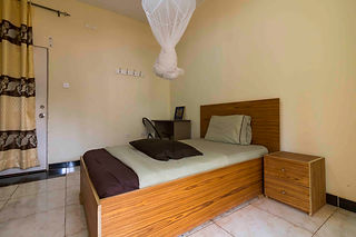 Single twin bed hotel room in Huye, Rwanda