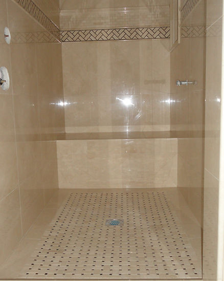 Shower wall & pan with marble.