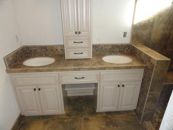 Vanity with tile countertop.