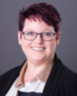 Sharon Spink corporate look wth glasses.
