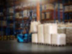 Forklift is handling jumbo bags in large