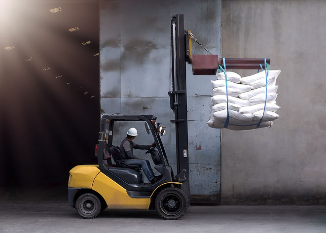 Forklift handling sugar bags outside fro