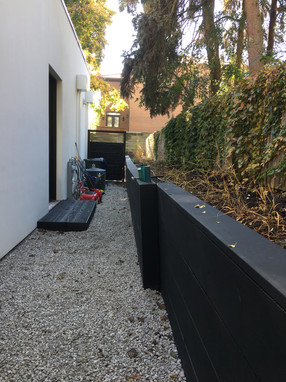 Timber Retaining Wall stained black, along side of house, Winnetka IL