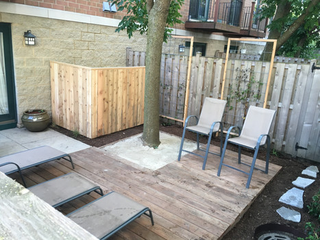 Cedar deck and low maintenance landscape planting in Chicago, IL