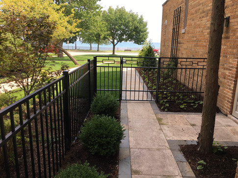 Stone walkway and metal fencing in Evanston, IL