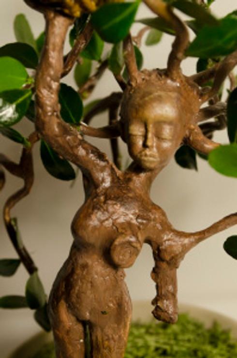 3 / 22 / 2015 Medium: Sculpey,  oil paint, leaves, a flower pot