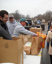 Doboszenski and Sons volunteering for local food drive