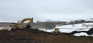 site development with backhoe and dozer
