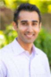 Dr Parikh with green background.jpg
